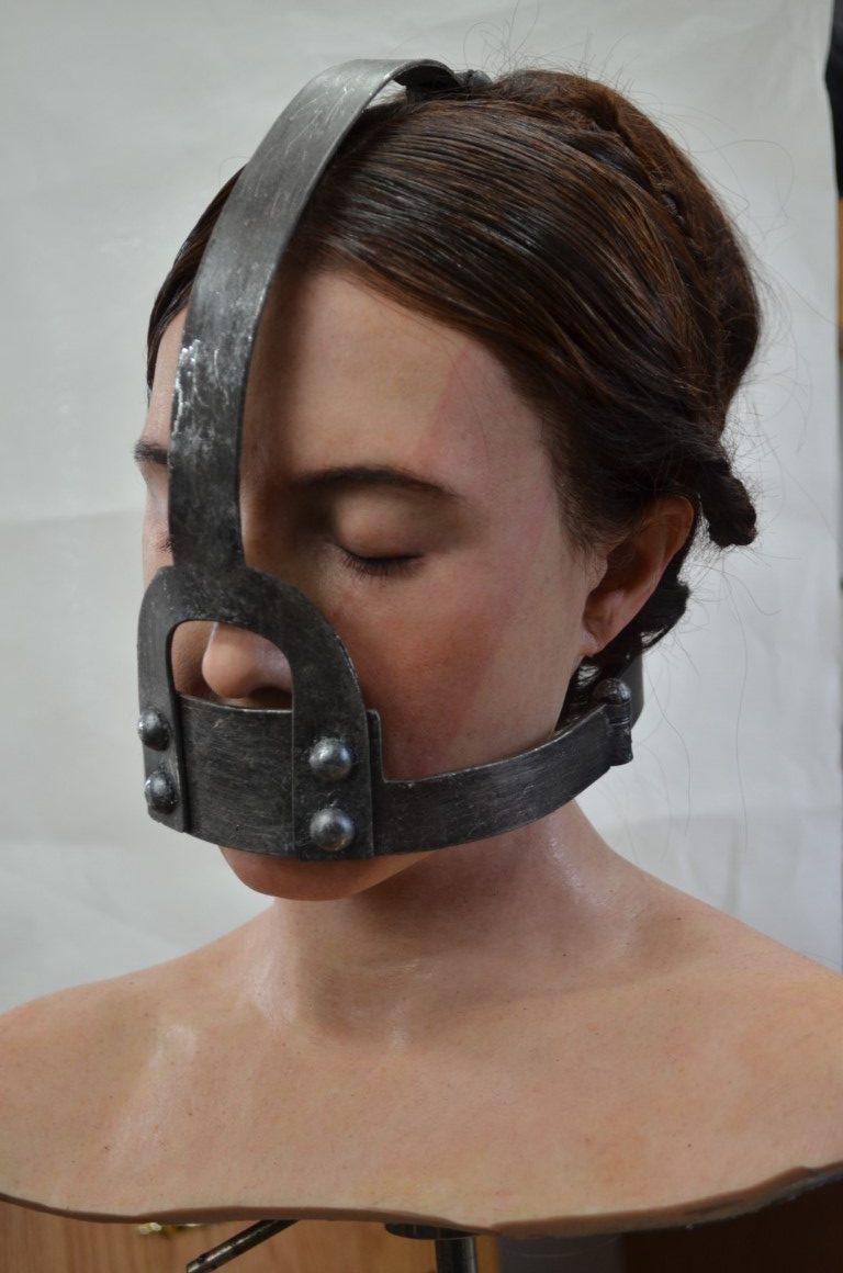 Silicone dummy head including The Scold's Bridle Brimstone (2016)