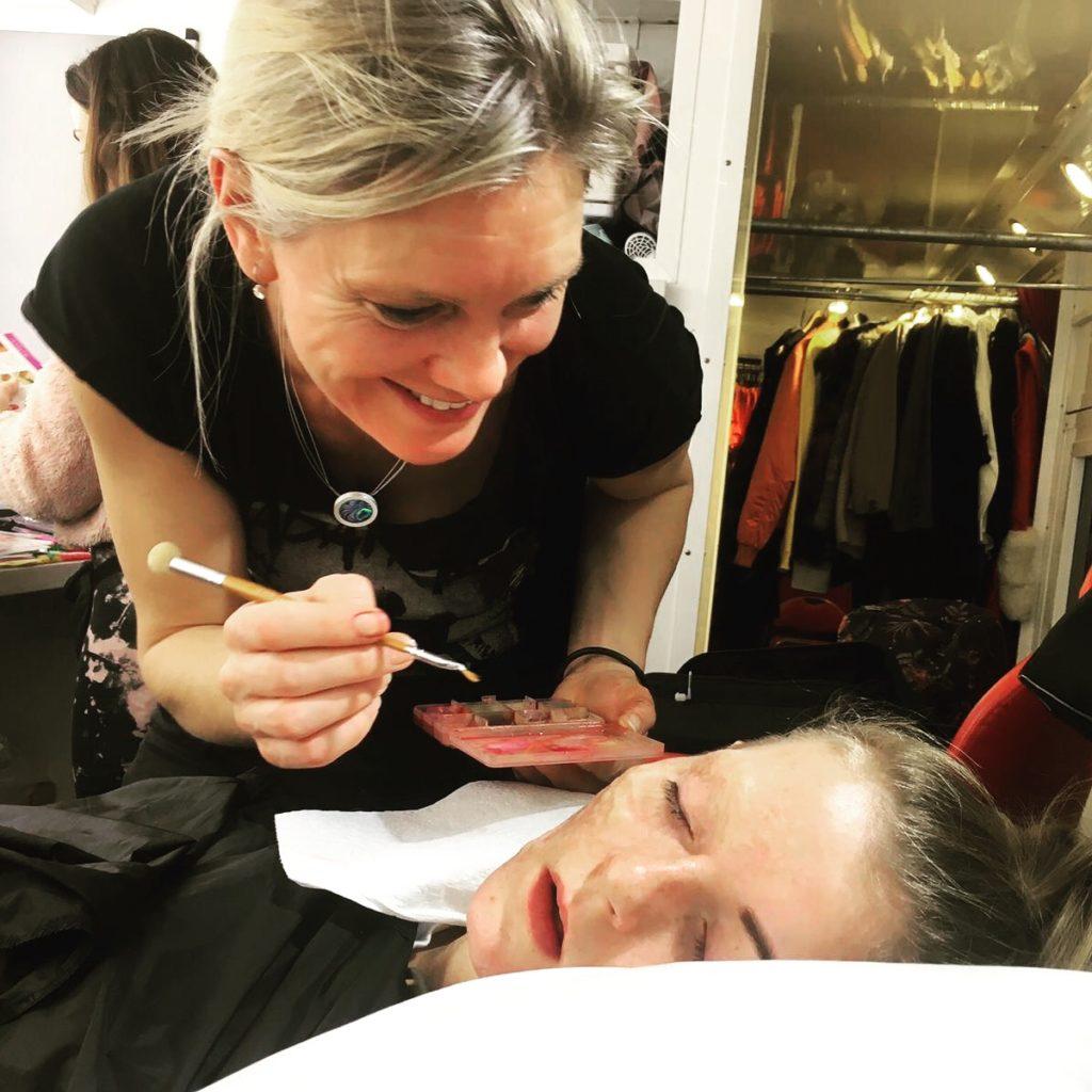 Special Make up Effects supervisor Carola Brockhoff applying prosthetics on set of Dirty God